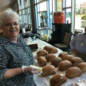 Representatives from Oklahoma Wheat with the bread donated to the event and served to attendees by the organization.
