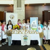The eight 2017 NFOB finalists with the baked goods donated to the Bake For Good program, sponsored by King Arthur Flour.