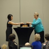 Cindy Falk and Julene DeRouchey, co-chais of the National Festival of Breads, announce the winner of the 2017 NFOB.