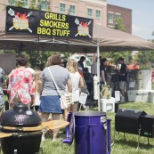 Folks enjoying the popular outdoor barbeque portion of the NFOB