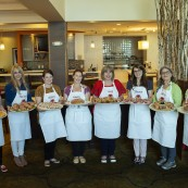 The eight finalists with their breads.