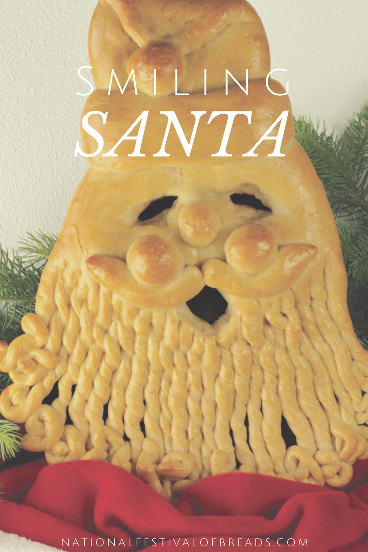 This Smiling Santa bread sculpture is perfect for the holidays! Use it either as a DIY Christmas centerpiece or munch away with party guests as they marvel at your artistic talents. This bread recipe is a winner!