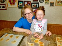 Hurd baking with one of her four grandchildren